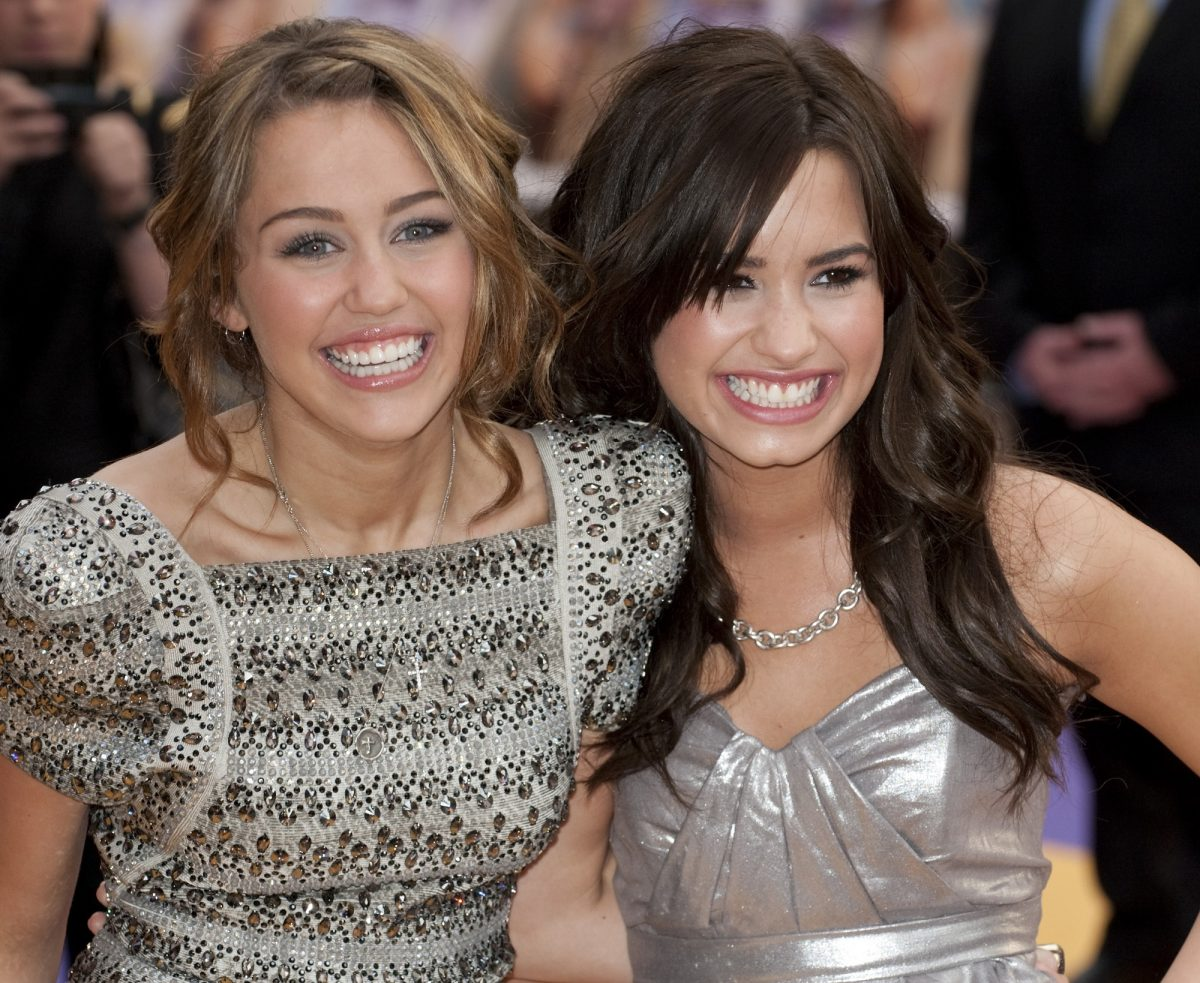 Miley Cyrus and Demi Lovato (R) at the UK premiere of 'Hannah Montana'