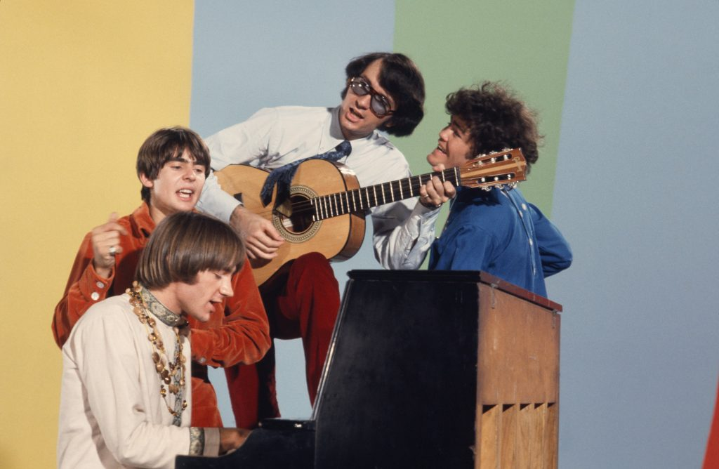 The Monkees at a piano