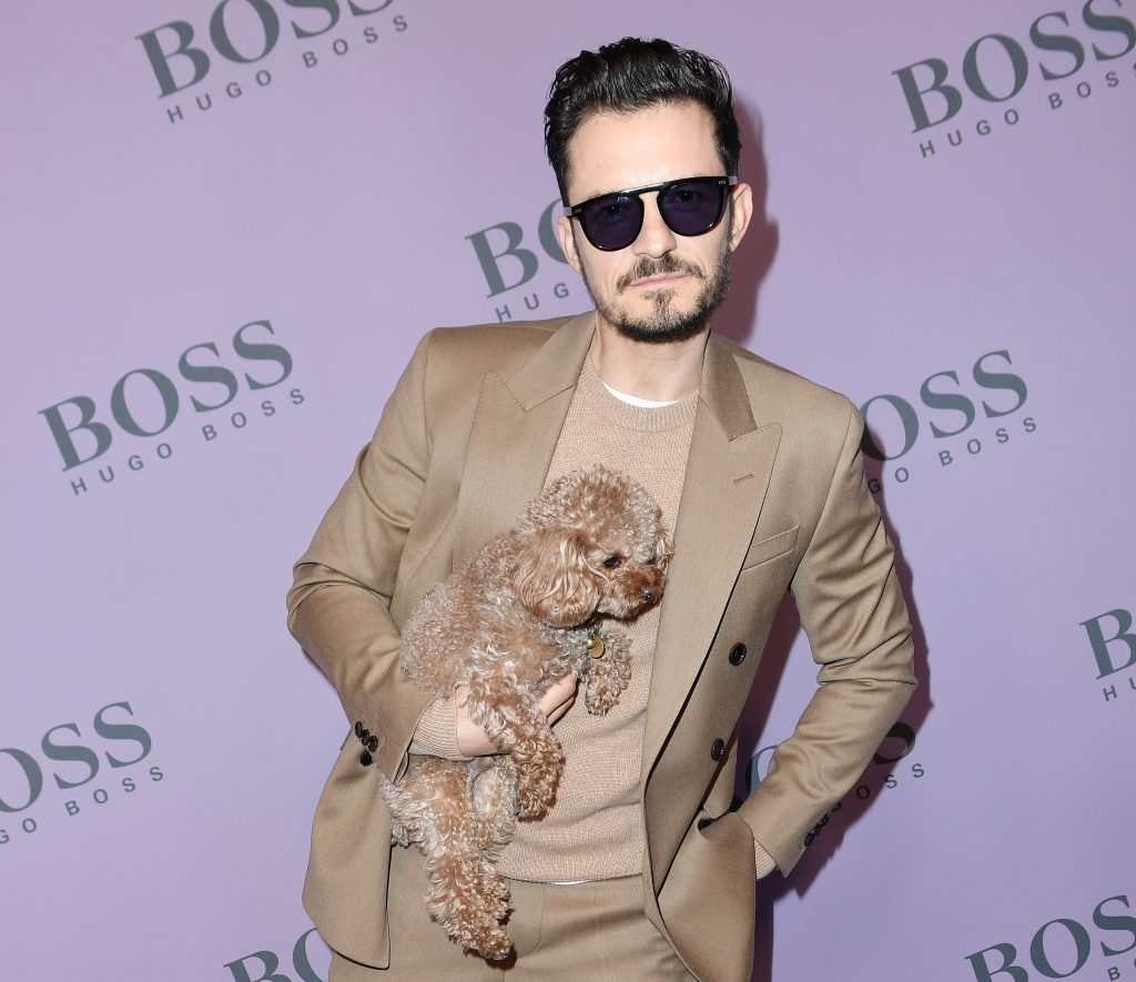 Orlando Bloom with his dog Mighty attend the Boss fashion show on February 23, 2020 in Milan, Italy.