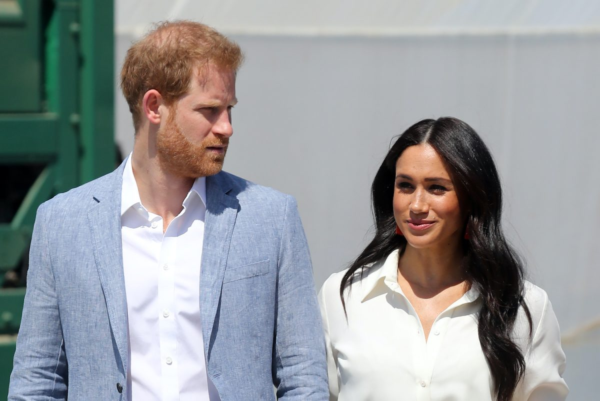 Prince Harry and Meghan Markle standing next to each other