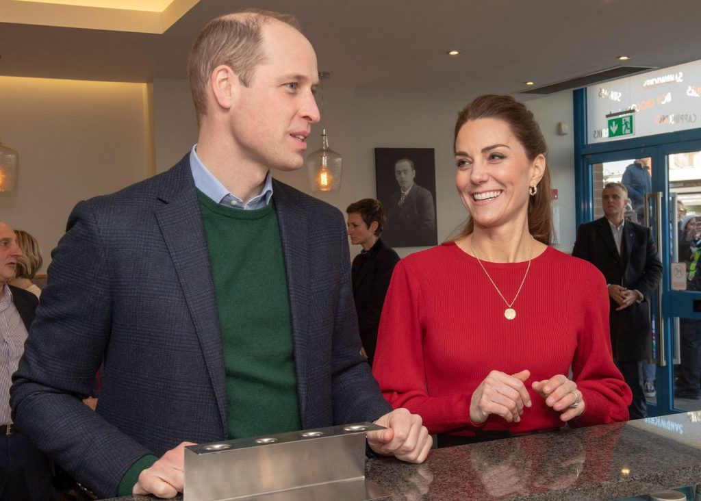 Prince William and Kate Middleton chat at the counter during their visit to Joe's Ice Cream Parlour in Mumbles, south Wales