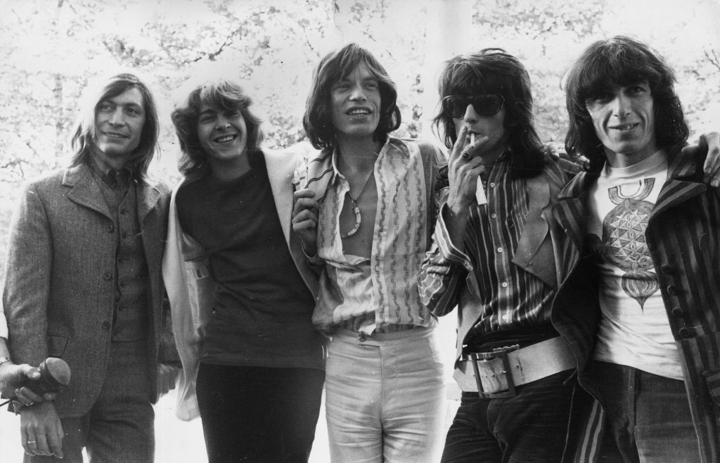 The Rolling Stones standing in a row