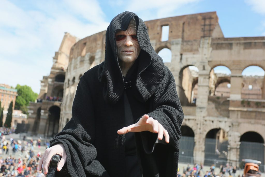 An Emperor Palpatine cosplayer by the Colosseum