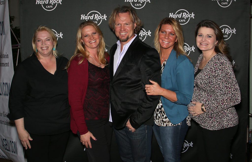 Kody Brown (C) and his wives, (L-R) Janelle Brown, Christine Brown, Meri Brown, and Robyn Brown of Sister Wives
