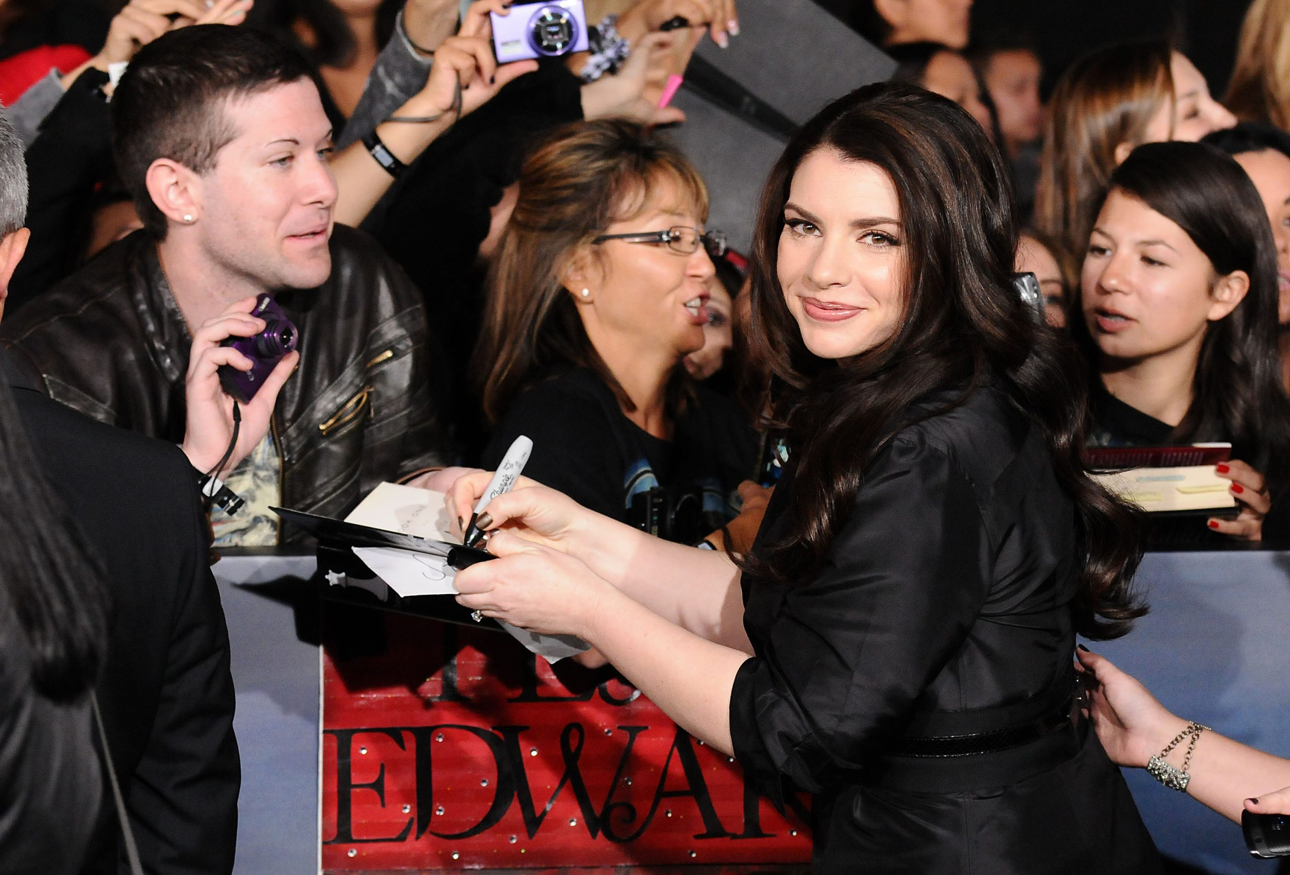 Stephenie Meyer signing autographs at the premiere of 'The Twilight Saga: Breaking Dawn - Part 2' on November 12, 2012