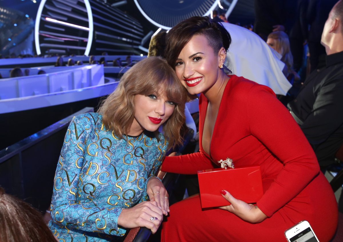 Taylor Swift (L) and Demi Lovato attend the 2014 MTV Video Music Awards on August 24, 2014