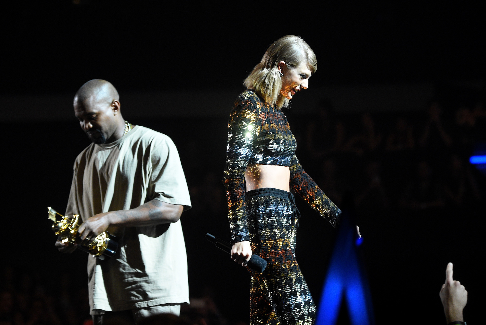 Kanye West accepts the Vanguard Award from recording artist Taylor Swift onstage during the 2015 MTV Video Music Awards.