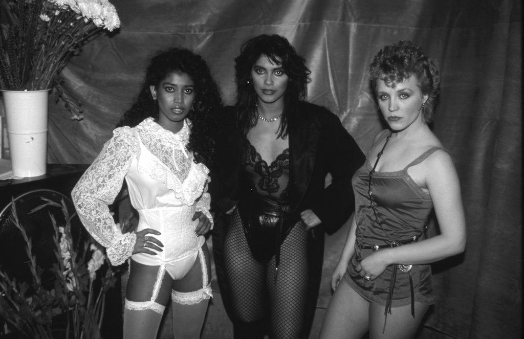 Vanity 6 near some flowers