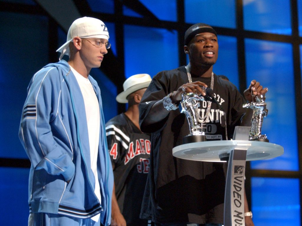 Eminem and 50 Cent at a podium