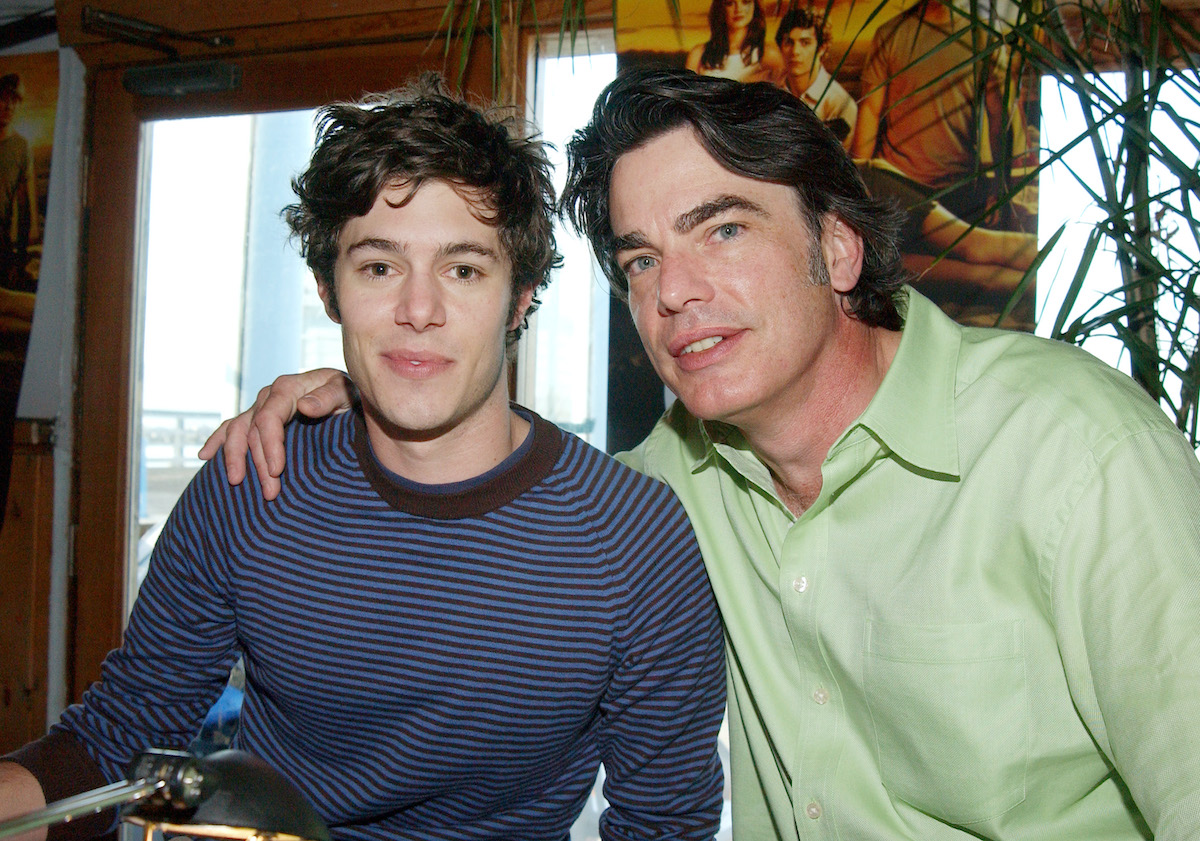 Adam Brody and Peter Gallagher pose together during a radio interview with the cast of 'The O.C.'