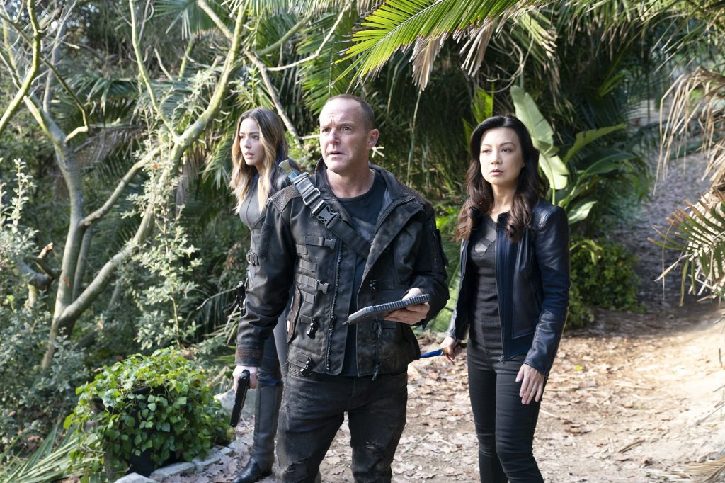 Chloe Bennet, Clark Gregg, Ming-Na Wen on a path surrounded by greenery