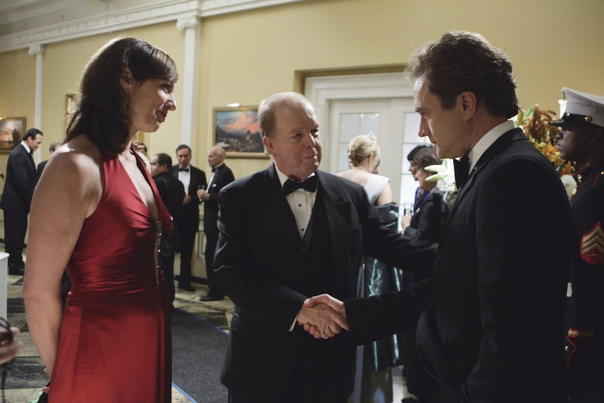 Allison Janney, John Aylward, and Bradley Whitford in 'The West Wing'
