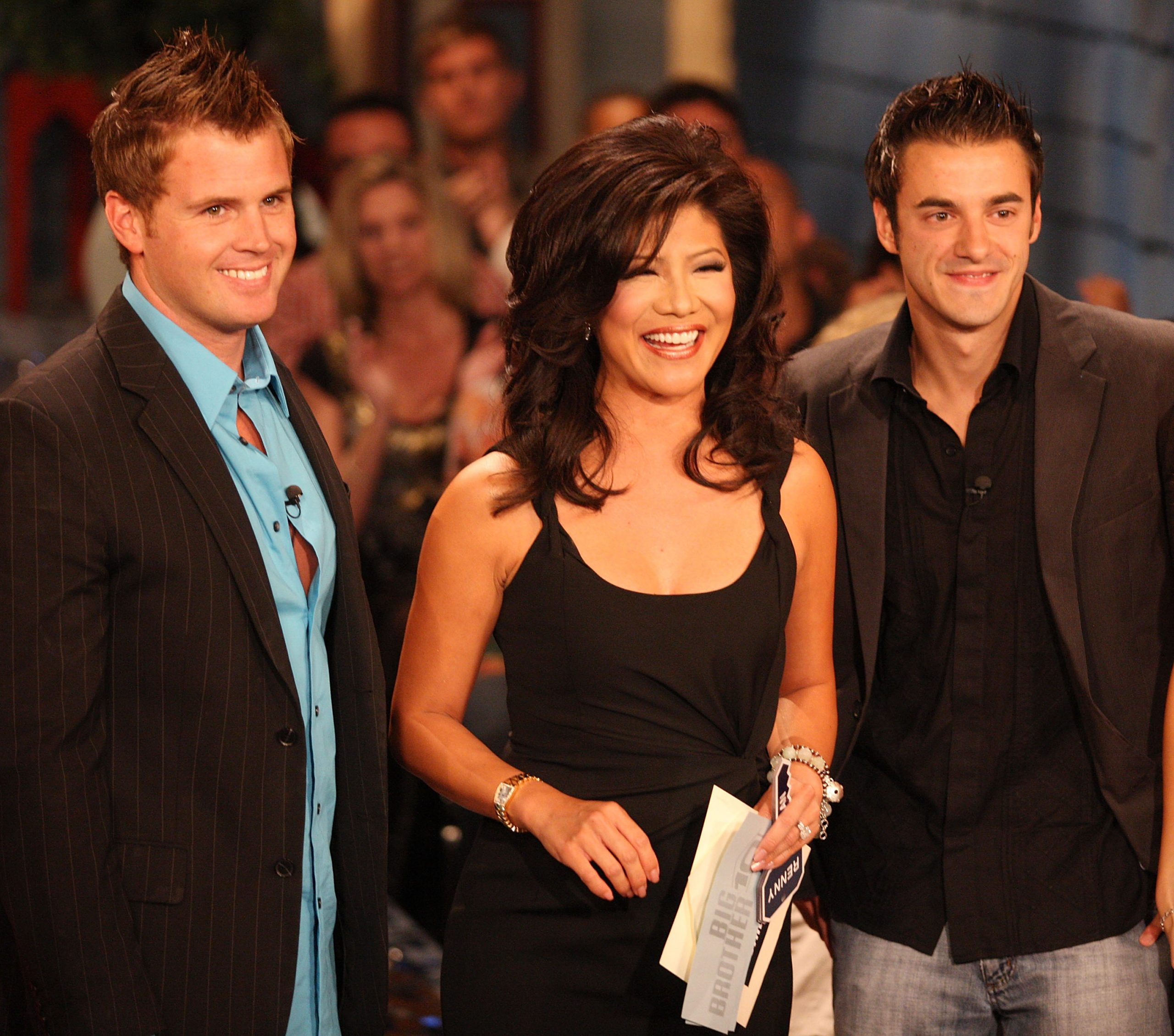 Second place contestant Memphis Garrett, host Julie Chen and Dan Gheesling the winner of the Big Brother Season 10 Grand Finale