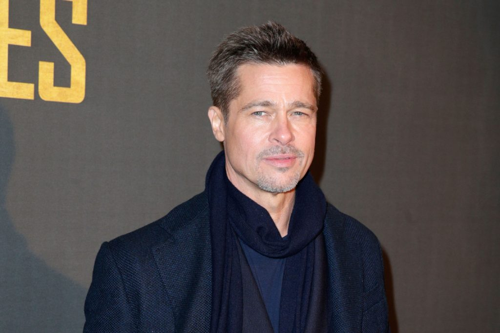 Brad Pitt poses as he arrives for the premiere of the film 'Allied'