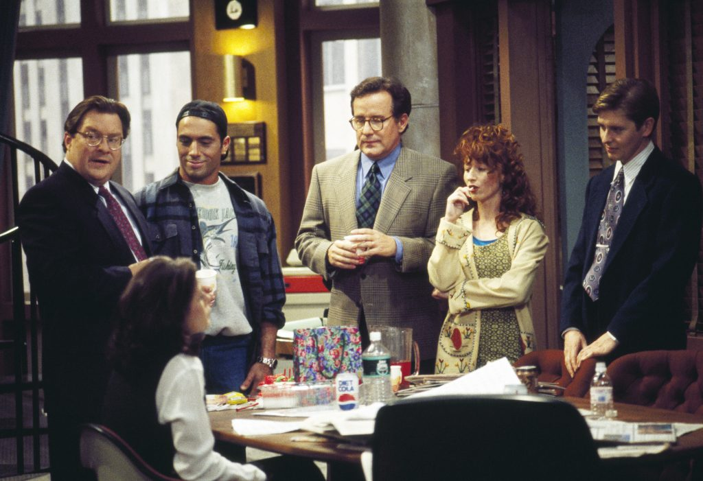 Cast of 'NewsRadio': (l-r) Stephen Root, Maura Tierney (seated), Joe Rogan, Phil Hartman, Vicki Lewis, and Dave Foley