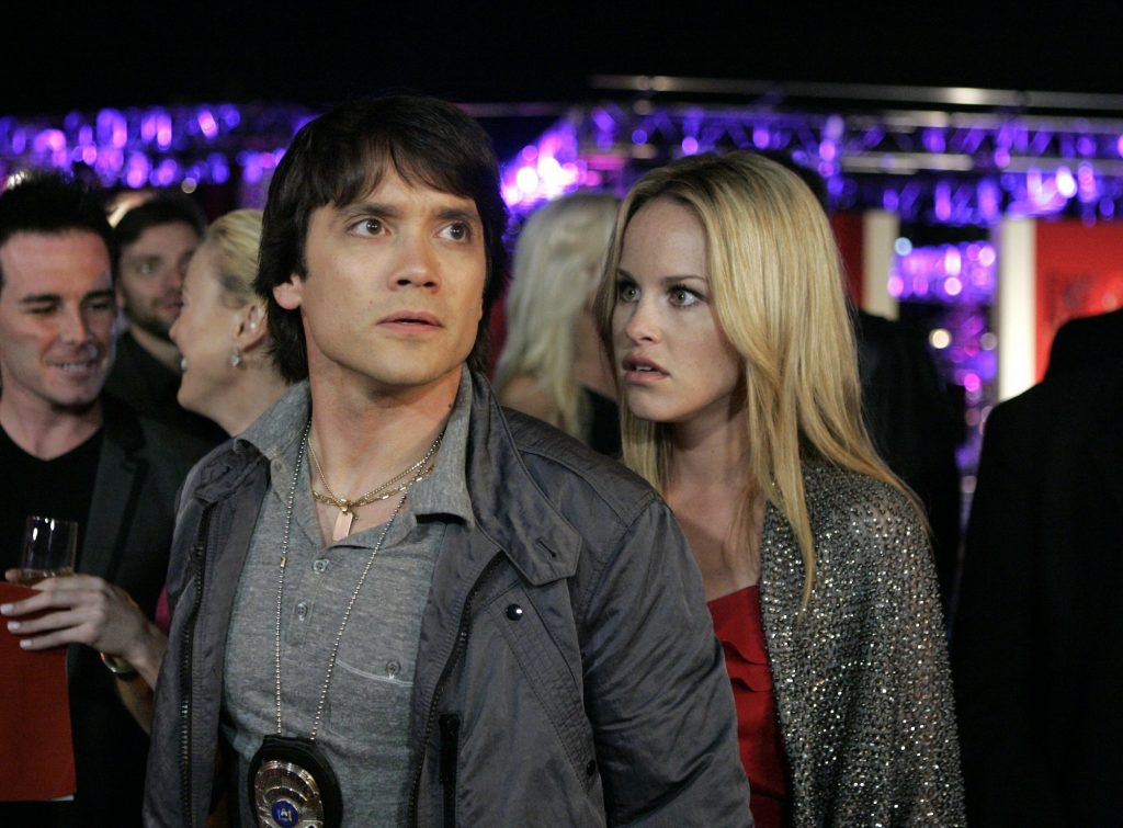 Dominic Zamprogna and Julie Marie Berman on 'General Hospital' looking away from the camera