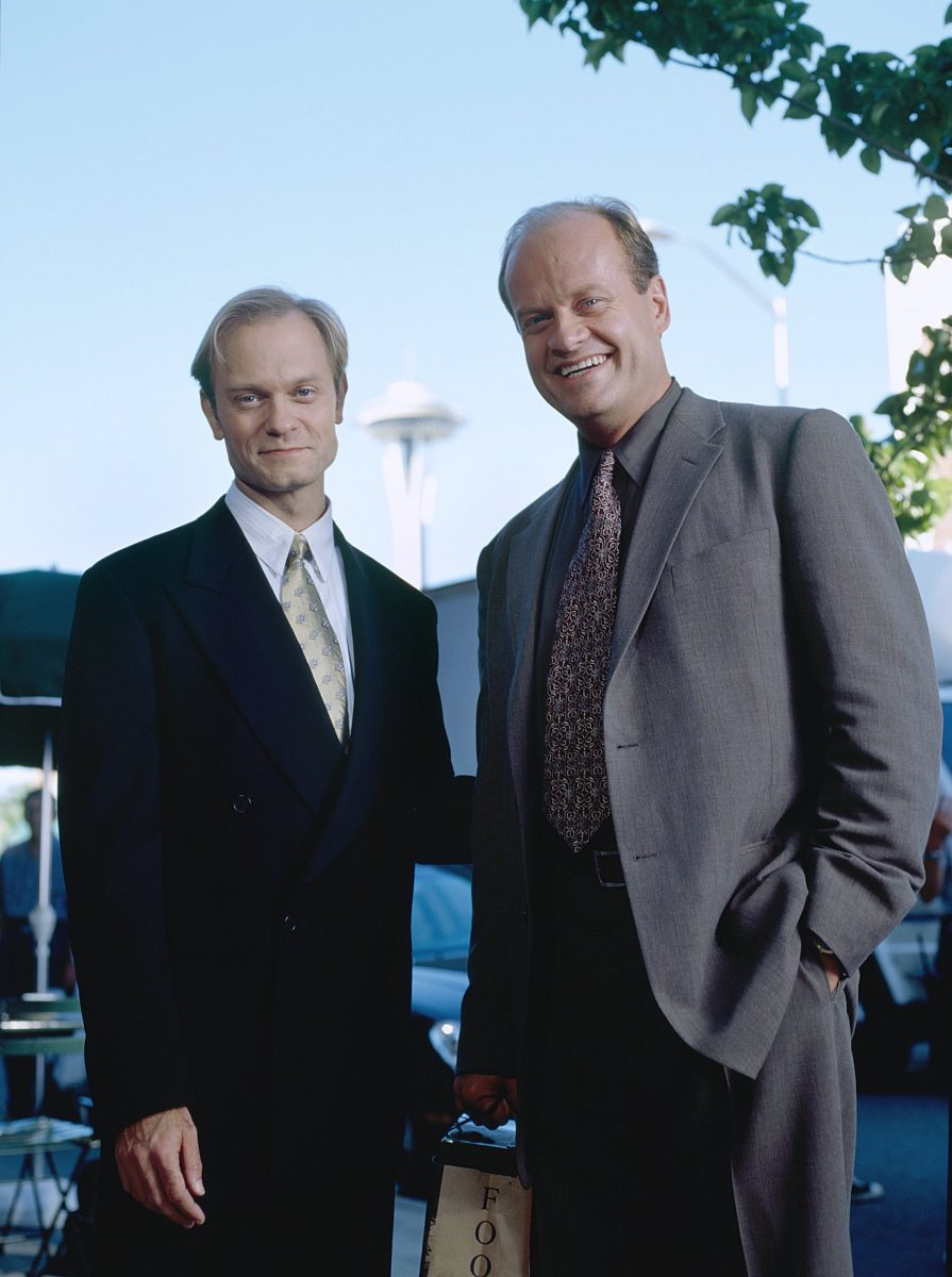 David Hyde Pierce and Kelsey Grammer standing in front of the Space Needle in 'Frasier'