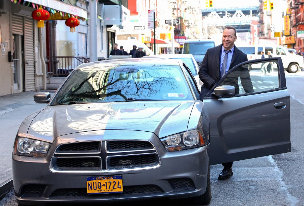 Donnie Wahlberg getting into a car on 'Blue Bloods'