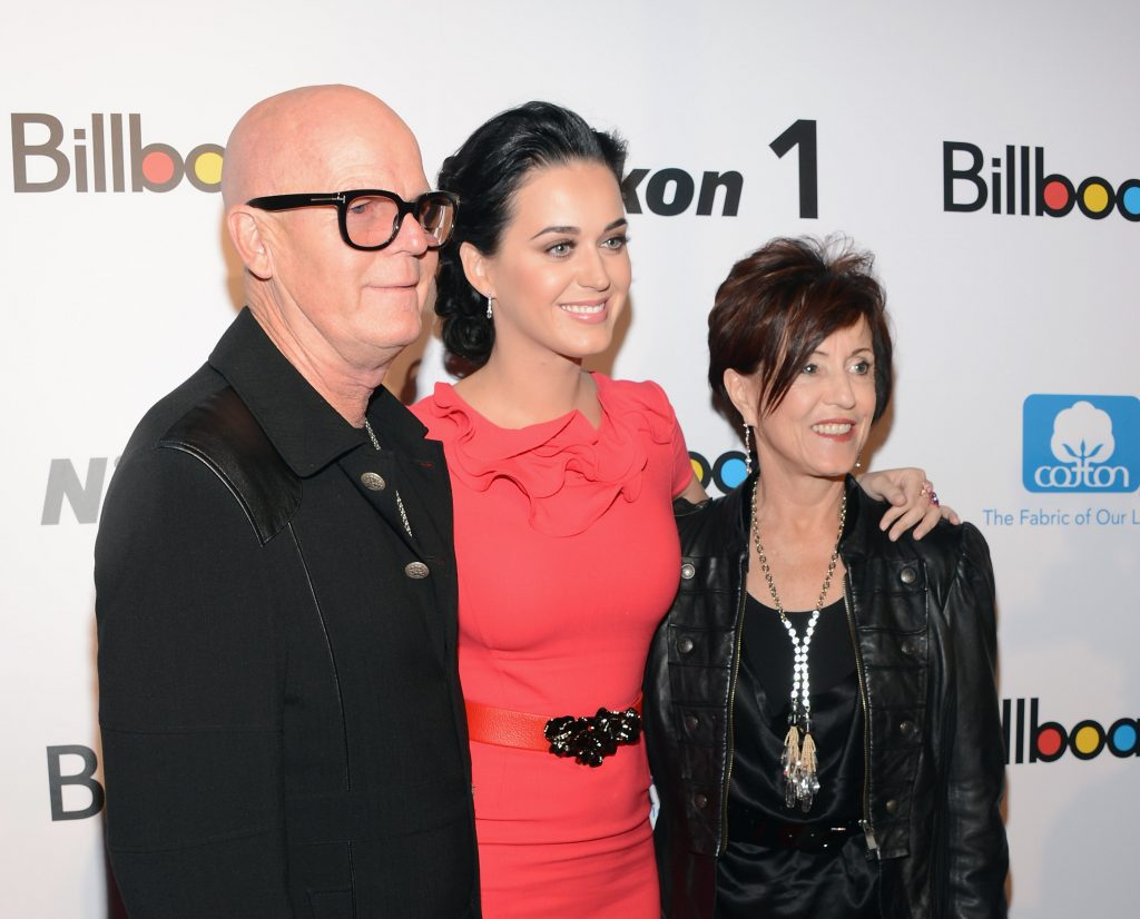 Katy Perry (center) with her father (left), Keith Hudson and mother (right) Mary Hudson in 2012