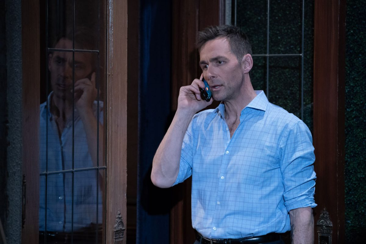 James Patrick Stuart making a phone call in a scene from 'General Hospital'