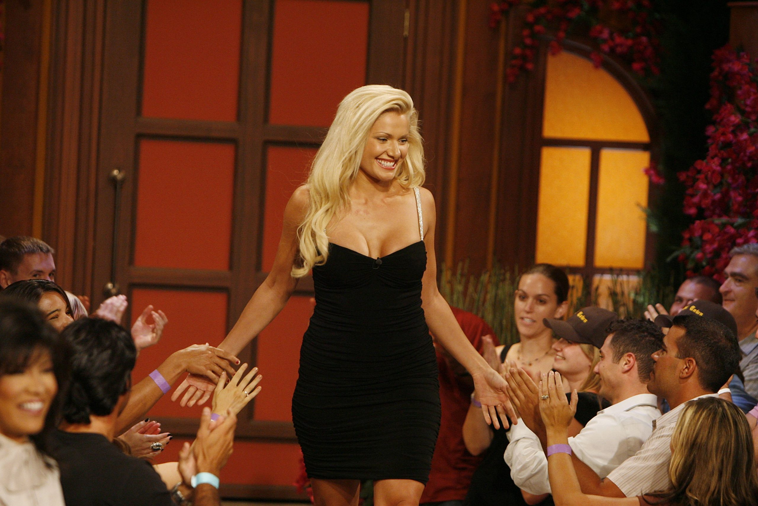 Janelle Pierzina greets audience members at Big Brother 7: All-Stars