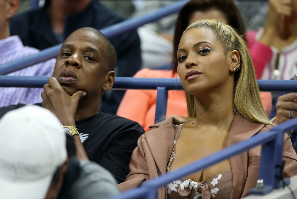 Jay-Z and Beyoncé at a sporting event
