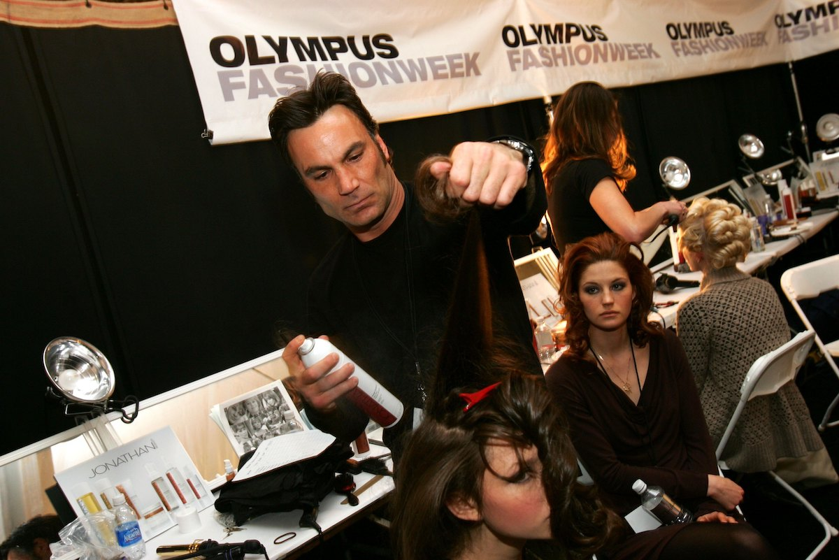 Stylist Jonathan Antin does a model's hair backstage at the Charles Nolan Fall 2006 fashion show