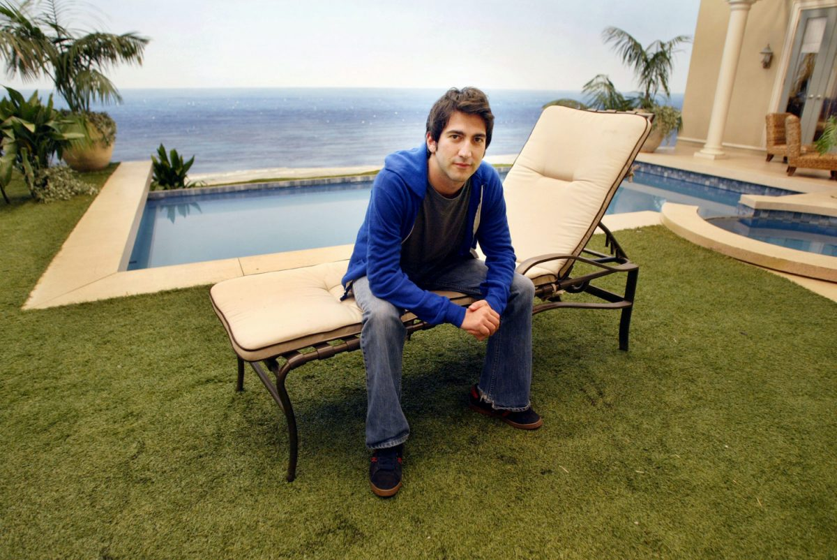 Josh Schwartz sits on a lounge chair on the set of 'The O.C.'