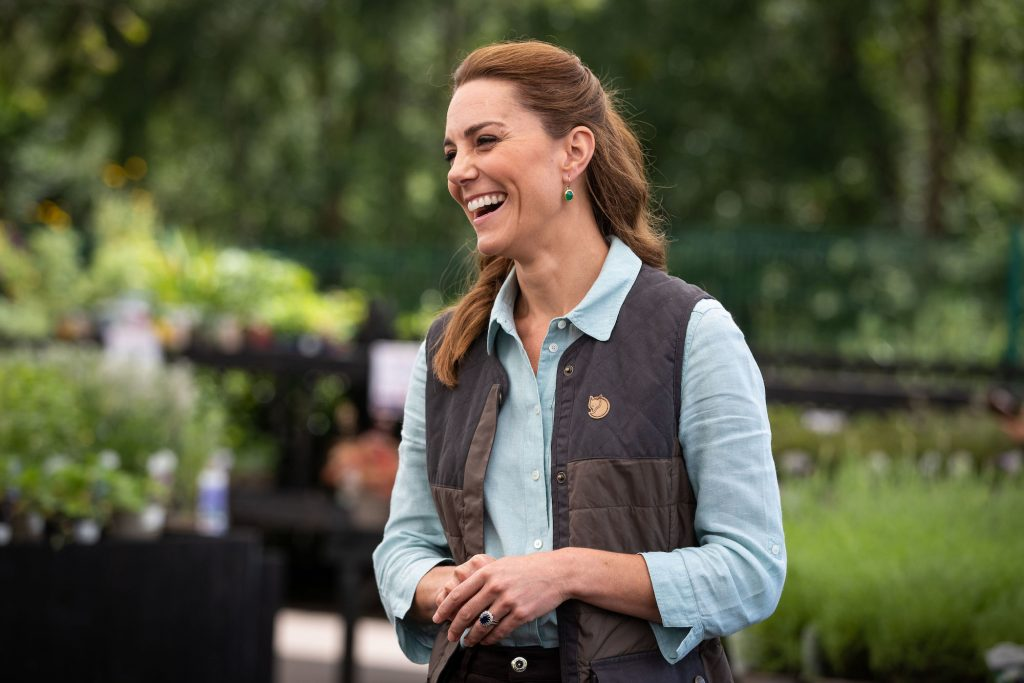 Kate Middleton laughing, turned to the side
