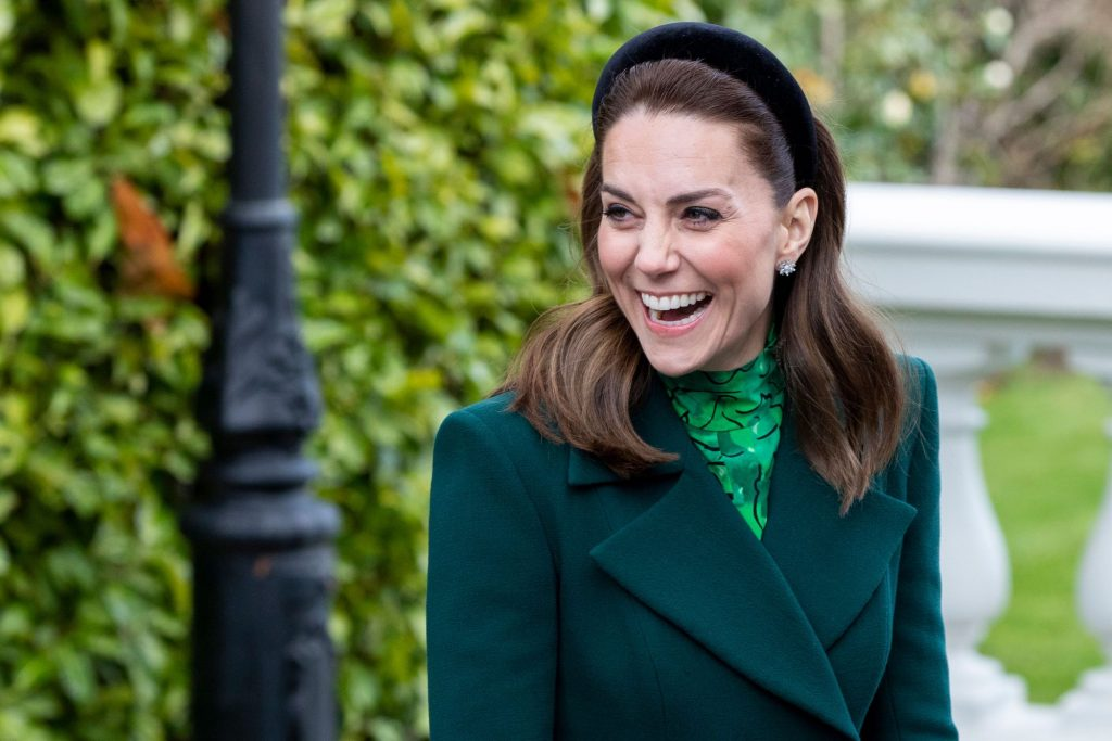 Kate Middleton, looking off camera, laughing