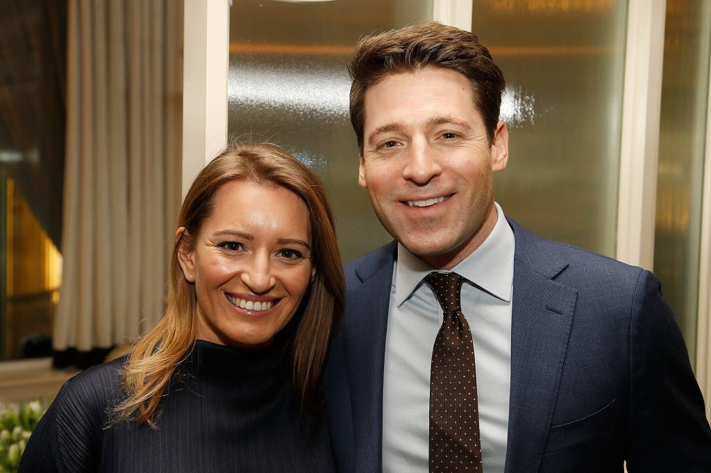 Katy Tur and Tony Dokoupil smiling at the camera in front of a window