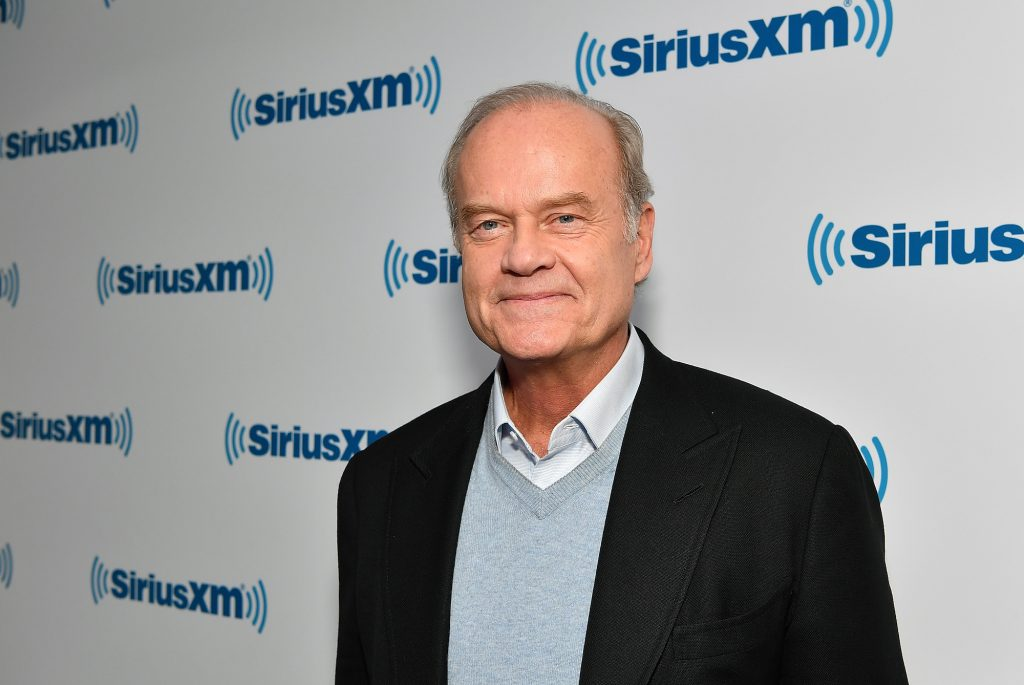 Kelsey Grammer smiling in front of a white background