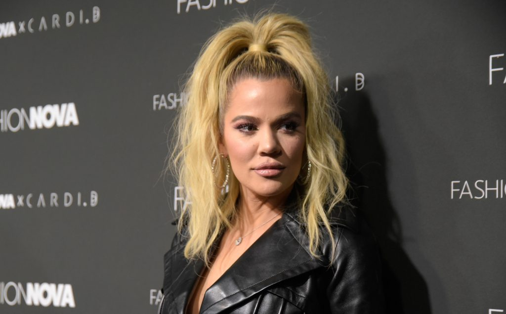 Khloé Kardashian in front of a repeating background