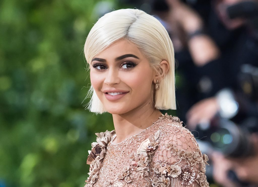 Kylie Jenner smiling looking to the side
