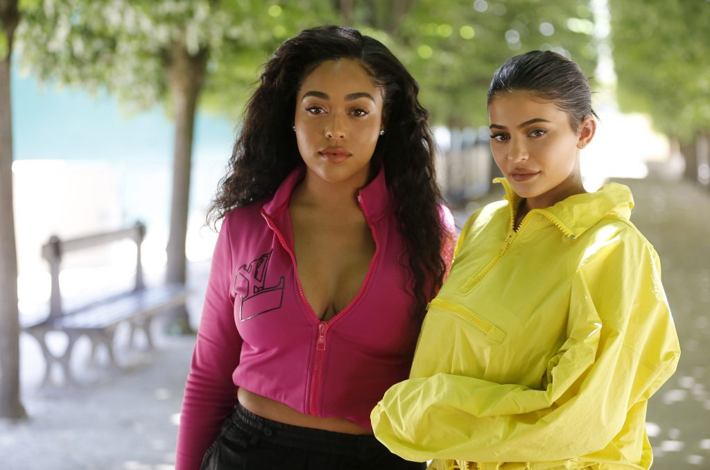 Jordyn Woods and Kylie Jenner standing outside
