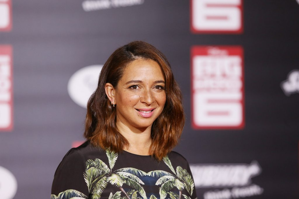 Maya Rudolph smiling in front of a blurred background