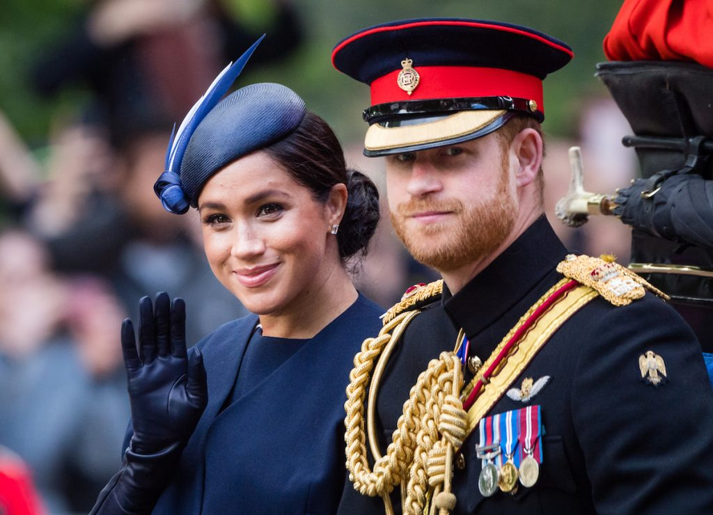 Prince Harry, Duke of Sussex and Meghan, Duchess of Sussex ride by carriage down the Mall during Trooping The Colour, the Queen's annual birthday parade, on June 08, 2019 in London, England