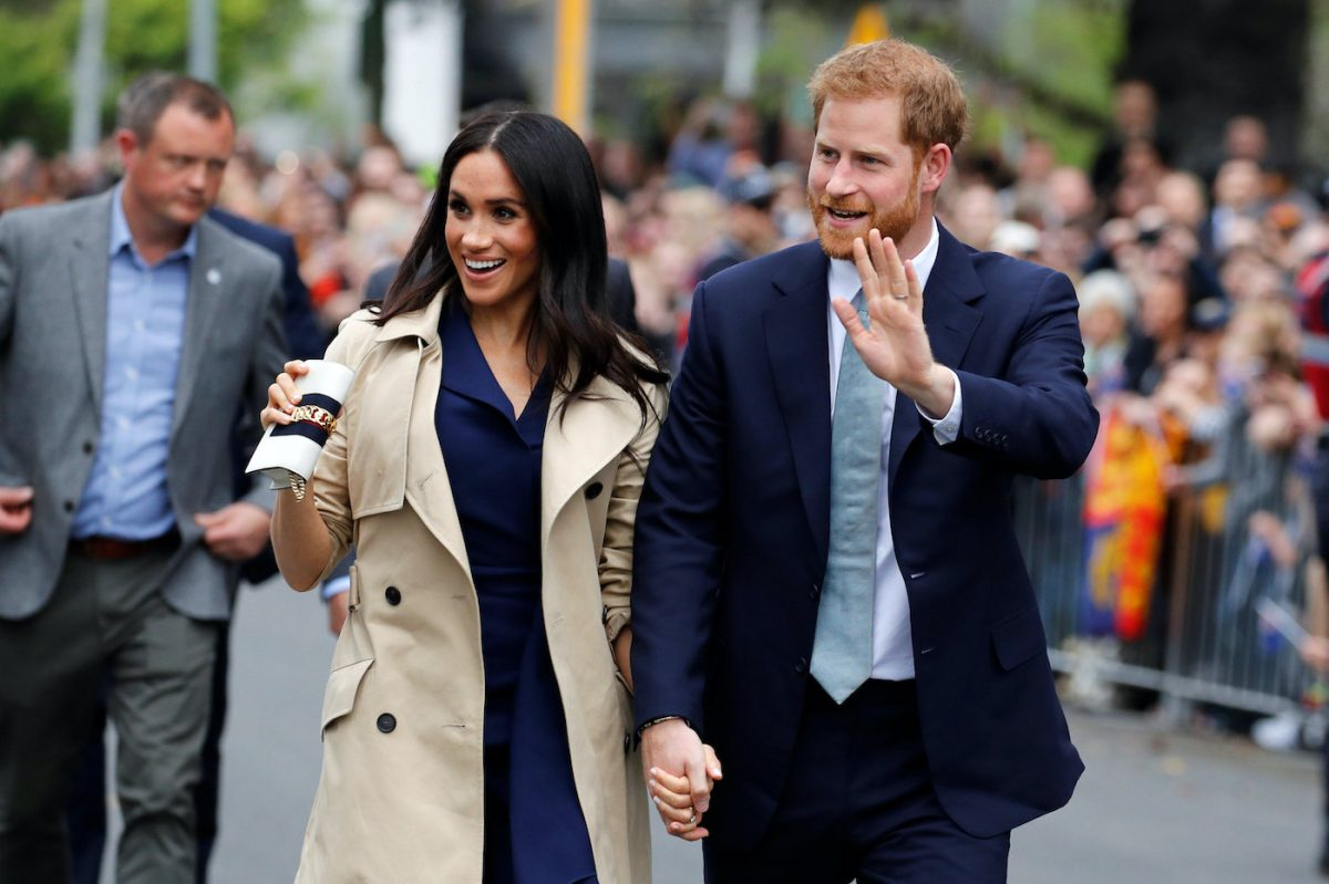 Meghan Markle and Prince Harry wave to crowds during a visit Australia in 2018