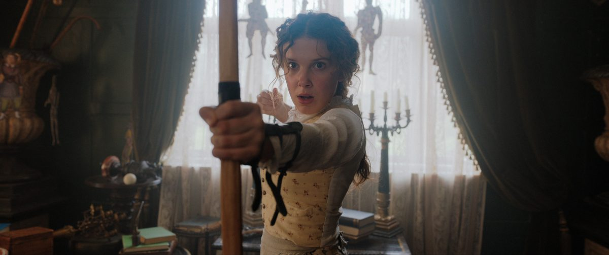 Millie Bobby Brown with bow and arrow
