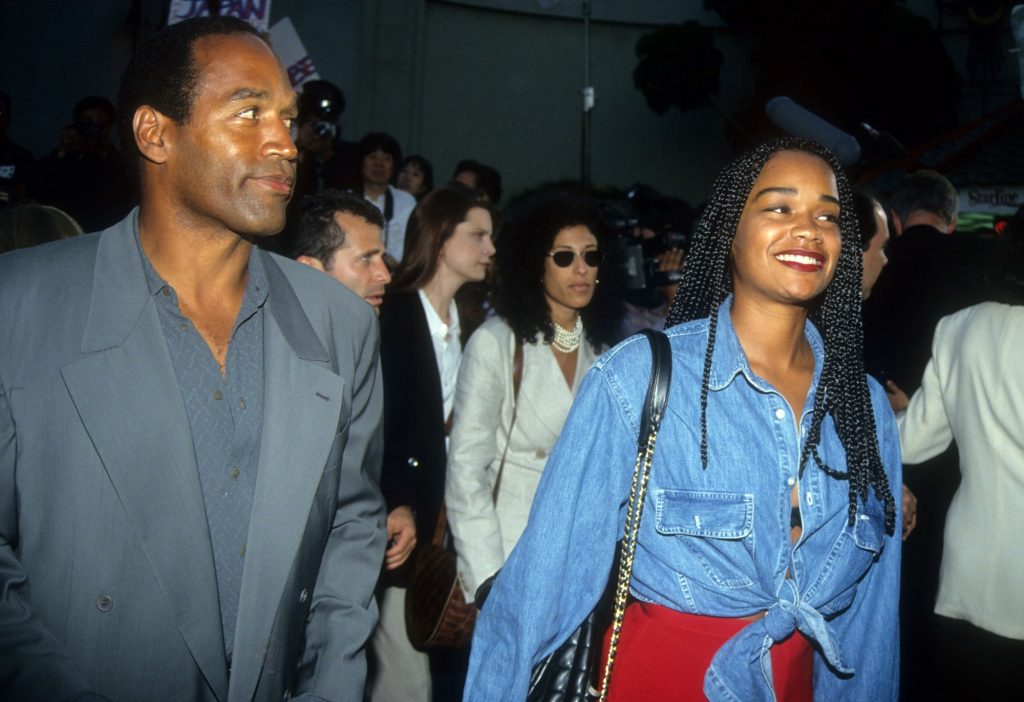 O.J. Simpson looking to the side and smiling with Arnelle Simpson smiling, looking off camera
