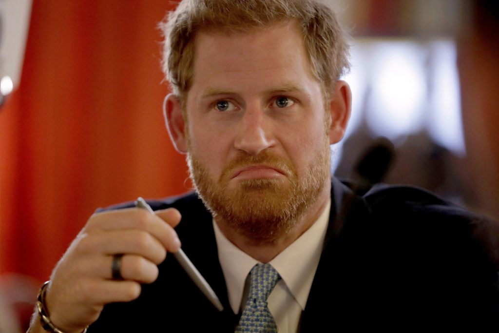 Britain's Prince Harry, in his role of Commonwealth Youth Ambassador, listens as he meets young people from across the Commonwealth in a roundtable discussion.
