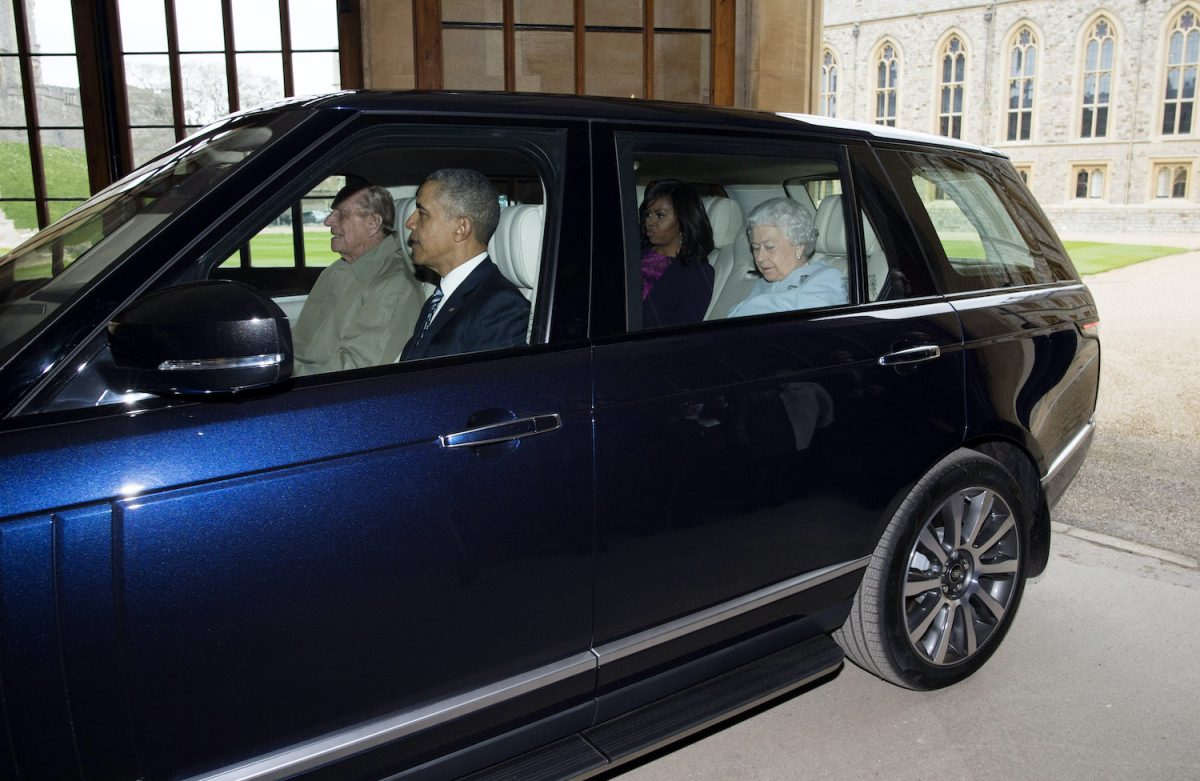 Prince Philip and Barack Obama ride in the front seat of a Range Rover while Queen Elizabeth II and Michelle Obama ride in the back seat