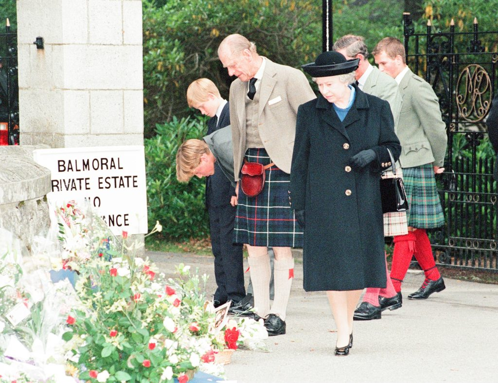 Queen Elizabeth II, Prince Philip, Prince Charles, Prince William, Prince Harry, and Peter Phillips look at Princess Diana tributes outside Balmoral