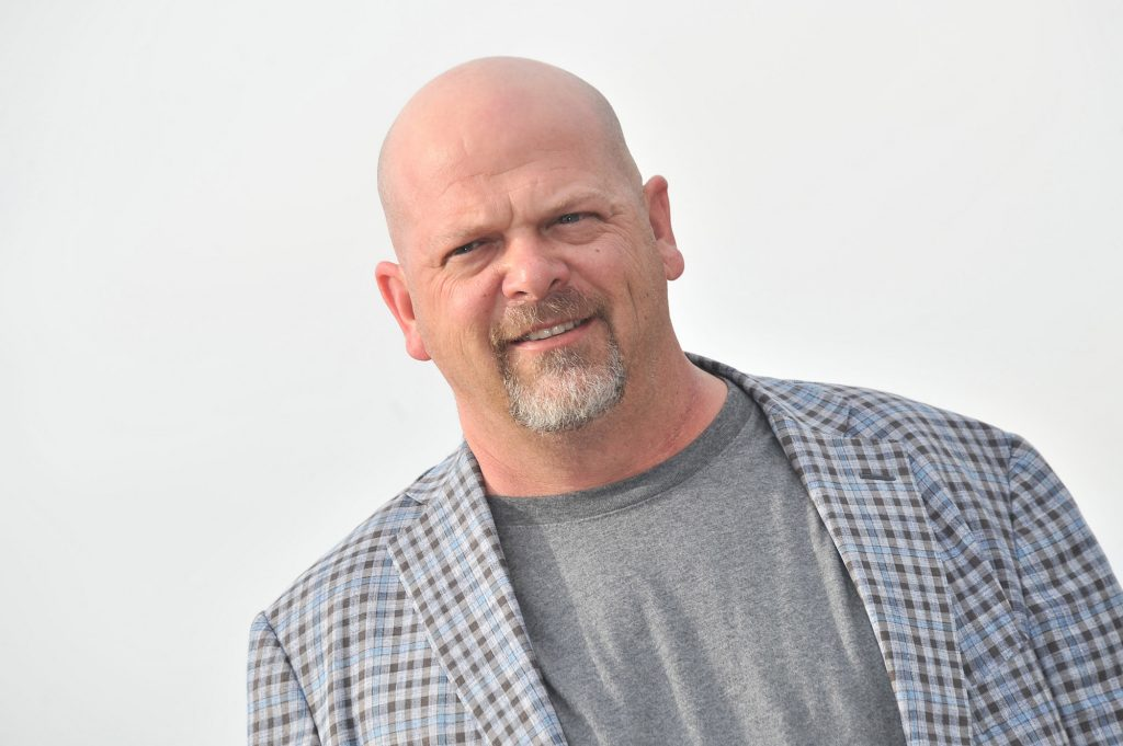 Rick Harrison smiling in front of a white background