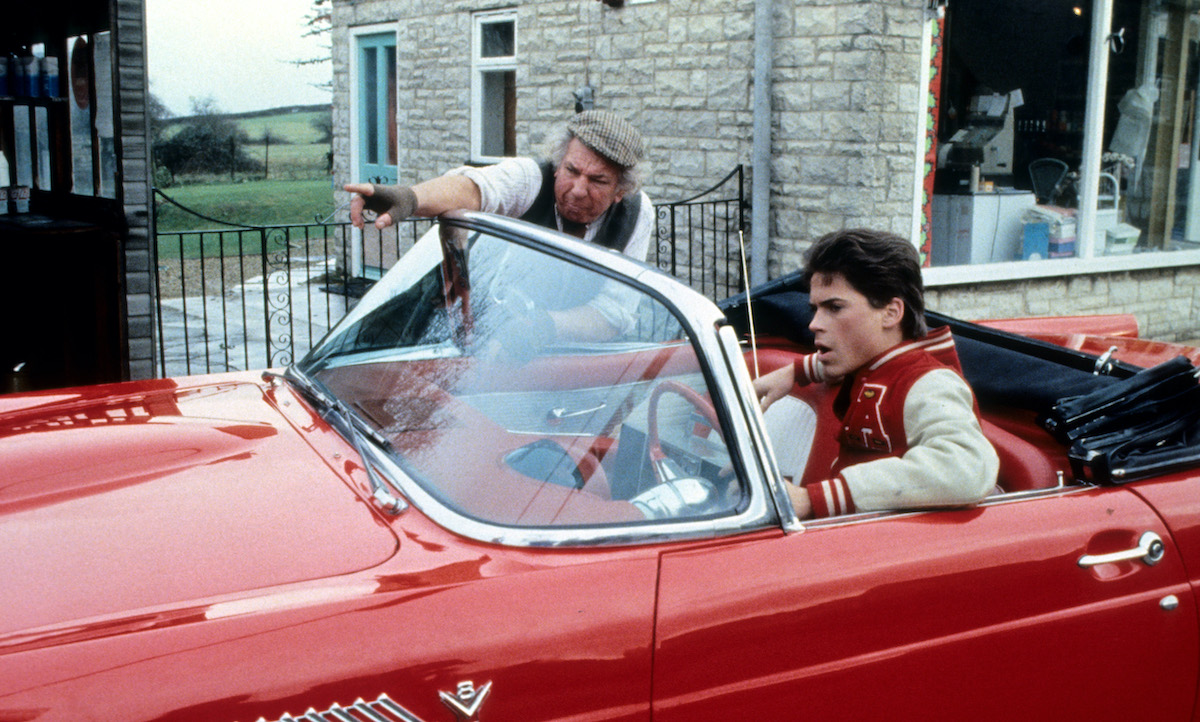 Rob Lowe getting directions in his convertible in a scene from the film 'Oxford Blues'