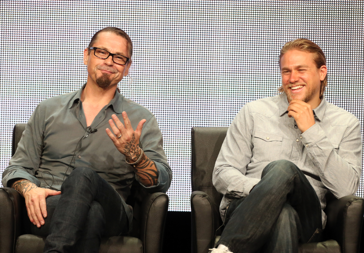 """Creator/Executive Producer Kurt Sutter and actor Charlie Hunnam speak onstage during the """"Sons of Anarchy"""" panel discussion at the FX portion of the 2013 Summer Television Critics Association tour - Day 10 at The Beverly Hilton Hotel on August 2, 2013"""