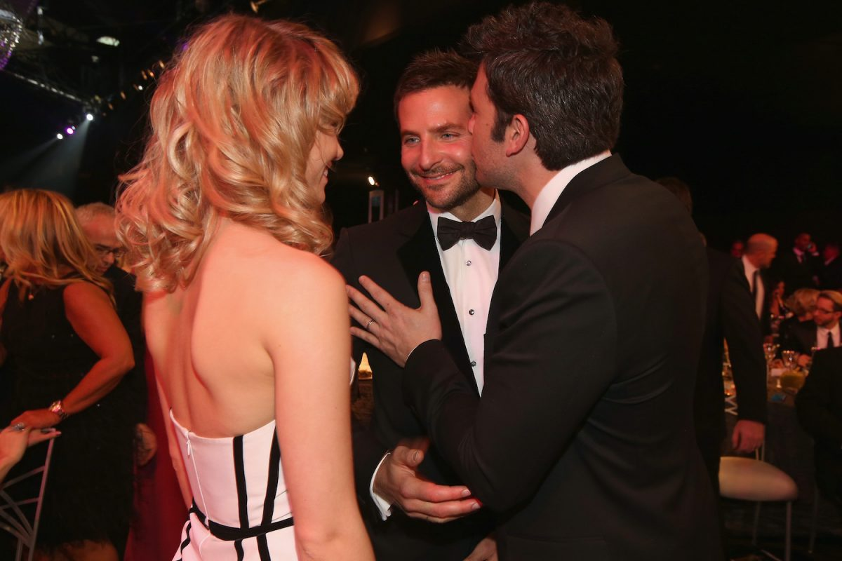 Suki Waterhouse watches as Bradley Cooper gets a kiss on the cheek from Ben Affleck at the 2014 Screen Actors Guild Awards