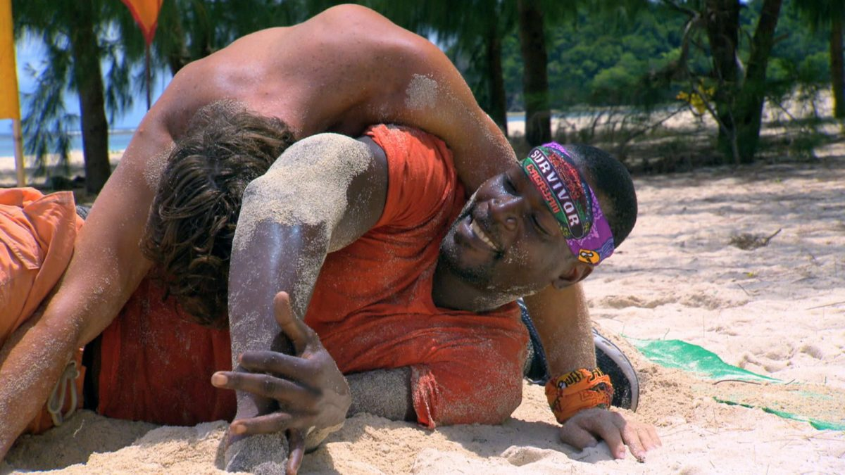 Jeremiah Wood and Cliff Robinson wrestle during the reward challenge on the fourth episode of Survivor: Cagayan