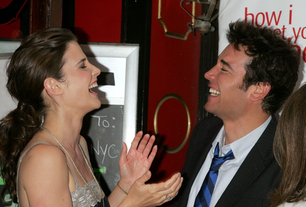 Josh Radnor and Cobie Smulders laughing.