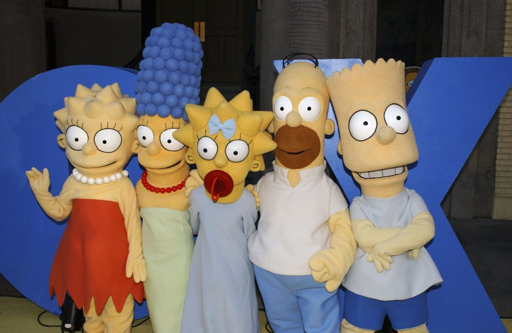 """Lisa, Marge, Maggie, Homer and Bart Simpson pose for a photograph at """"The Simpsons"""" 350th episode block party"""